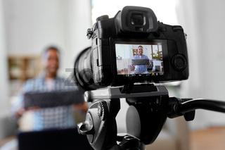 camera recording blogger with computer keyboard