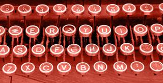 Coral pink toned keyboard of vintage typewriter