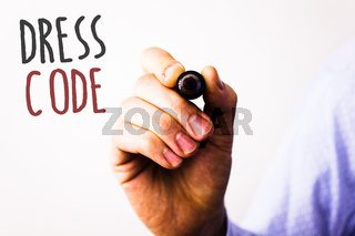 Conceptual hand writing showing Dress Code. Business photos text Rules of what you can wear and not to school or an eventMan holding pen pointing idea message black red letters white background.