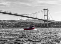 Turkish ship under the Bosphorus bridge of Istanbul, vintage style