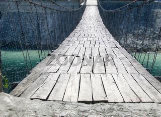 suspension bridge over mountain stream