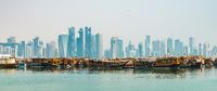 Doha cityscape and dhow boats in the foreground