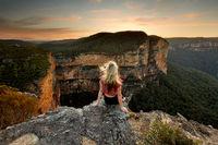 Sitting on rock watching the sunset mountain views
