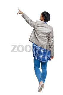 Back view of a young black girl in jeans and a checkered shirt.