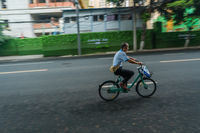 Chinese man riding on a bicycle in Chengdu