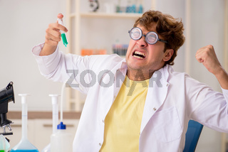Funny crazy chemist doing experiments and tests
