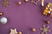 Christmas frame of golden ornaments