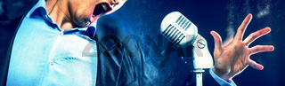 Cropped image caucasian expressive man open mouth singing on vintage white microphone. Image with digital effects, horizontal view
