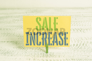 Text sign showing Sale Increase. Conceptual photo Average Sales Volume has Grown Boost Income from Leads Green clothespin white wood background colored paper reminder office supply.