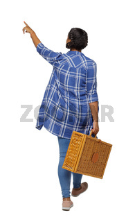 Back view of a young black girl in jeans with a picnic bag.