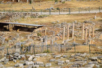 Top view of the excavation site in ruined ancient city of Hierapolis. The remains of destroyed buildings and columns.