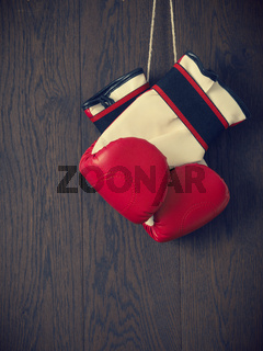 Boxing gloves on a wooden background
