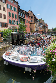 sightseeing cruise in Strasbourg with passenger boat passing through the river locks on the canals in the historic old town