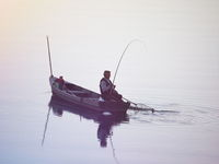 Fisherman Pulling his Catch