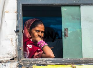 Indian woman in the train window