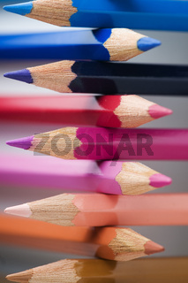 colored pencils cross-stacked blue on top