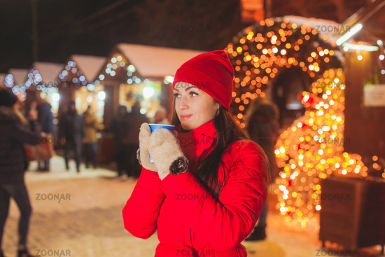 Portrait of attractive woman drinking tea outdoors