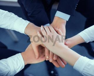 Hands folded together