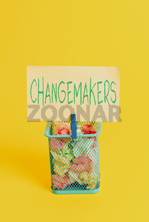 Handwriting text Changemakers. Concept meaning Young Turk Influencers Acitivists Urbanization Fashion Gen X Trash bin crumpled paper clothespin empty reminder office supplies yellow.