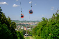 Red cable cars in mountain landscape in summer