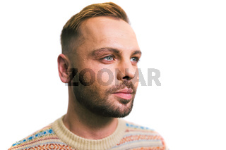 Portrait of a young caucasian stylish and fashionable man with a beard. Homosexual man, gay model posing