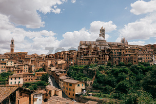 Panoramic view of Siena city with historic buildings and street