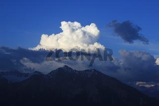 Cumulus cloud over Mount Lenzer Horn, Switzerland.