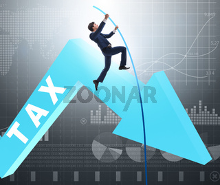 The businessman jumping over tax in tax evasion avoidance concep