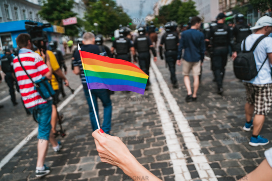 Hand hold a gay lgbt flag at LGBT gay pride parade festival