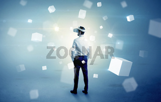Businessman with vr goggle and falling cubes