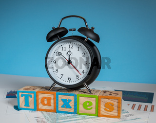 Income tax deadline approaching with alarm clock