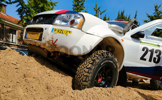 Rally car in pile of sand