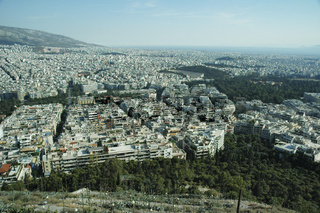 Aerial View Of Athens City, Greece. Aegean Sea At The Far Back