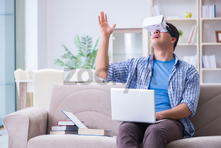 Freelance student with virtual reality glasses at home