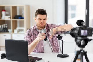 male blogger with microphone videoblogging