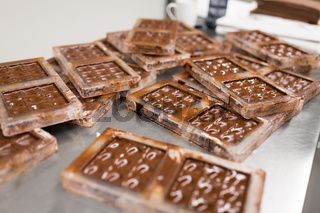 chocolate in candy molds at confectionery shop