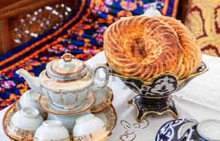 Fresh uzbek flatbread with sesame seeds on the holiday table