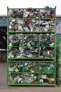 Electronic devices components waiting to be recycled in a container, on a recycling plant site. Pile of sorted electronic garbage.