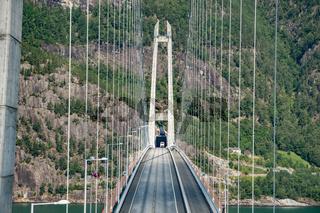 Hardanger Bridge. Hardangerbrua connecting two sides of Hardangerfjorden. Norway Hardangerfjord Hardanger bridge. newly built Hardangerbrua bridge close to Ulvik in Western Norway