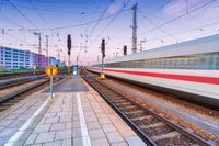 High speed train in motion on the railway station at dusk