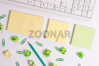 Note papers on the table with pc keyboard. Flat lay above blank copy space sticky notes with business concept. Blank papers for text messages.