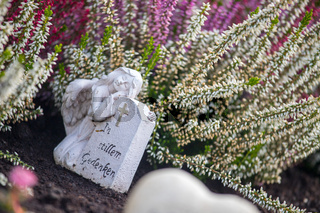 Marmoreal white Angel at the cemetery