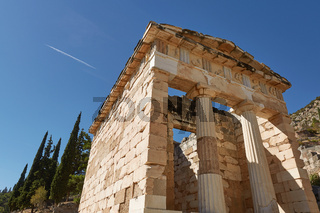 Low Angle View of The Athenian treasury in Delphi, Greece in a summer day.