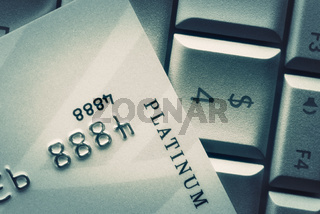 Credit Card On Keyboard. Consumerism, Online Purchase And Bank Credit Concept