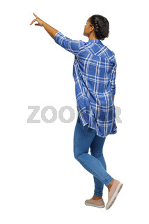 Side view of a young black girl in jeans and a checkered shirt. going girl showing. African American in a plaid shirt shows up. backside view of person.  Rear view people collection. Isolated over white background.