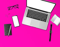 Office desk mockup top view isolated on magenta pink