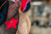 Red star with sickle and hammer detail on costume