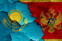 flags of Kazakhstan and Montenegro painted on cracked wall