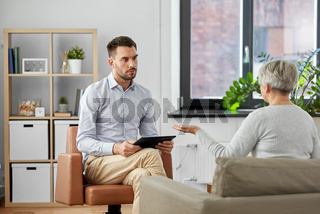 psychologist listening to senior woman patient