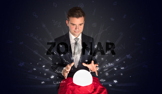 Businessman looking to inspiration in a magic ball and doodle concept